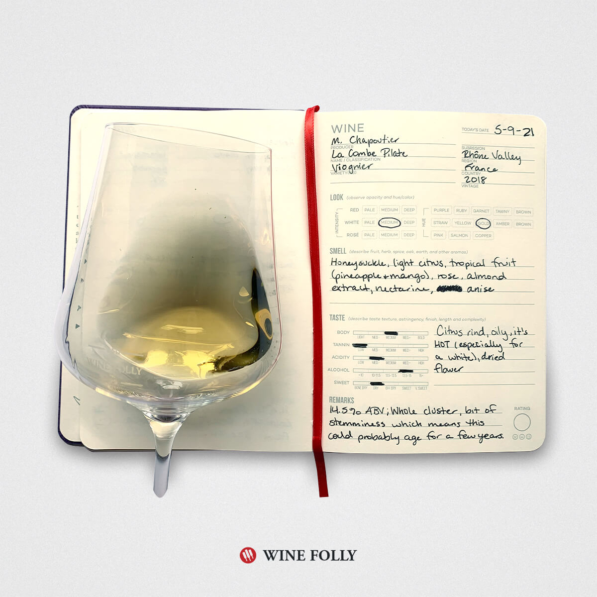 open wine journal with an entry about french viognier