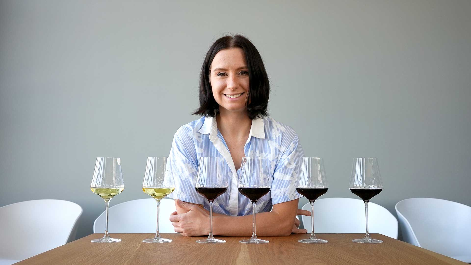Madeline Puckette with six Napa Valley wines