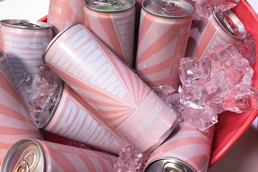Cans of Ramona rose in a bucket with ice.
