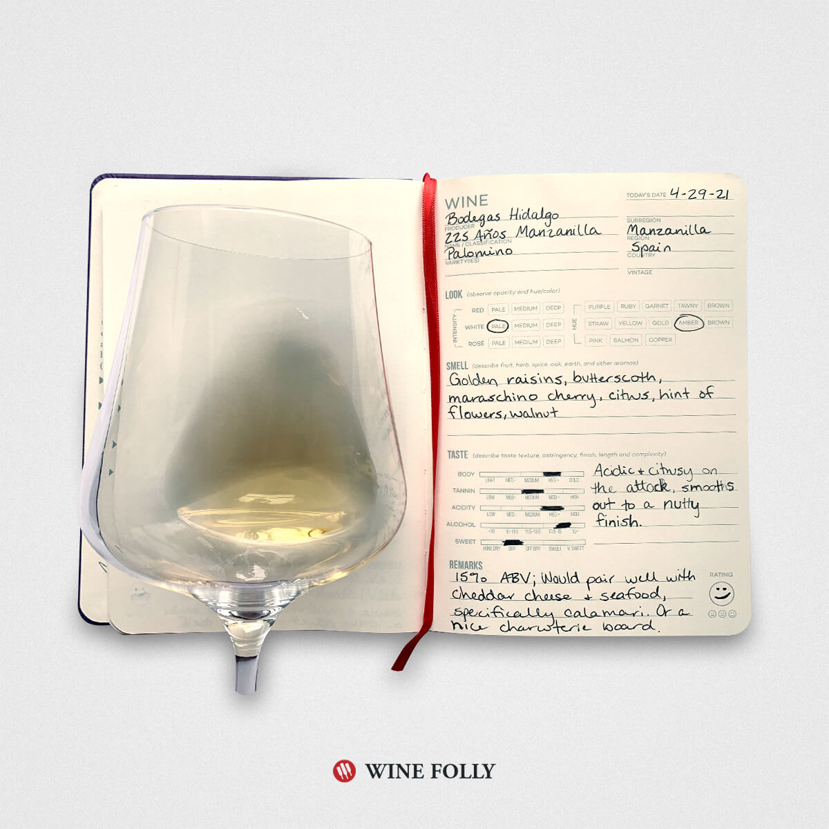 open wine journal with an entry about sherry